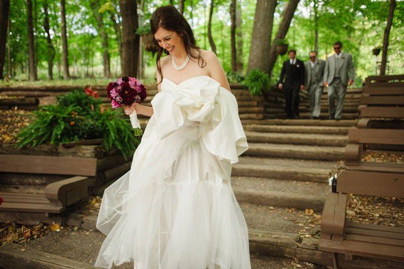 Bride walking down steps wedding at Woods Chapel Orono MN