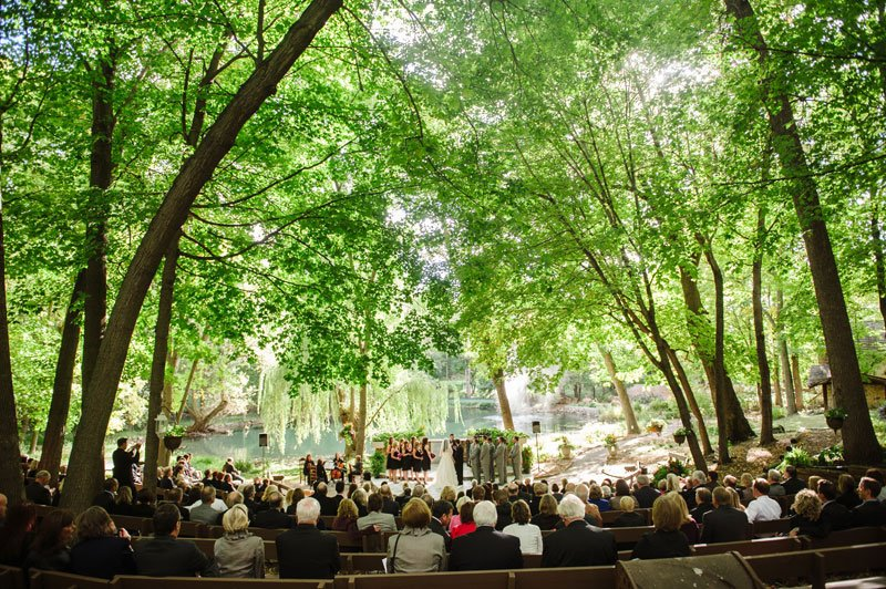 wedding ceremony in Woods Chapel September surrounded by trees Orono MN