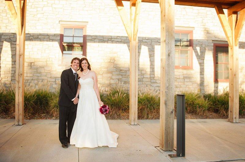 Bride and groom under arbor at Hazeltine golf club