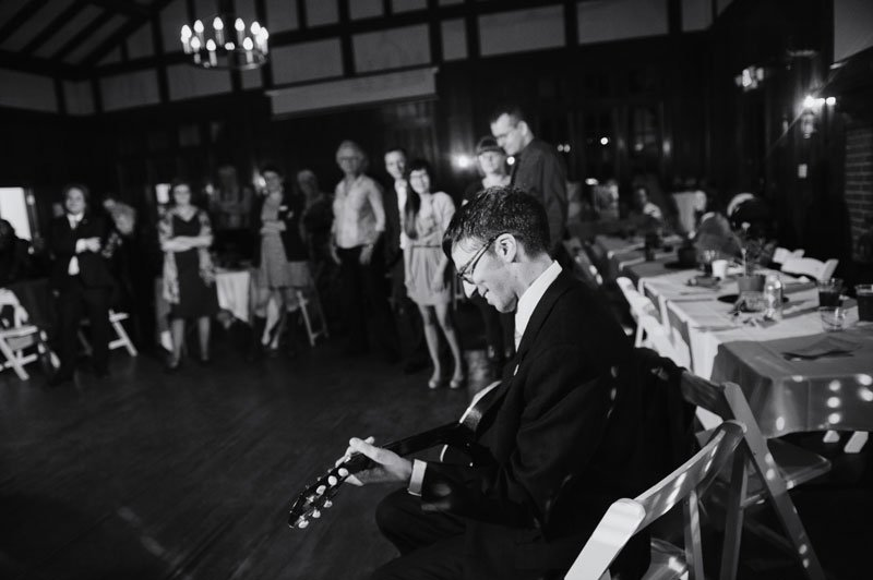 Groom serenades bride with guitar atTheadore Wirth Park Chalet Minneapolis