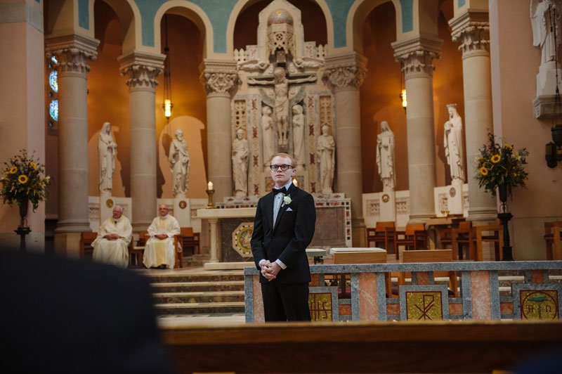 groom waits for bride at st thomas church wedding st paul mn