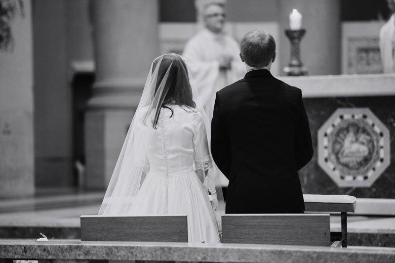 bride and groom during catholic ceremony st thomas church wedding st paul mn