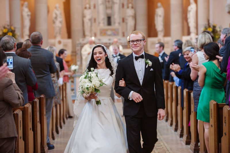 bride and groom walk down aisle after ceremony st thomas church wedding st paul mn