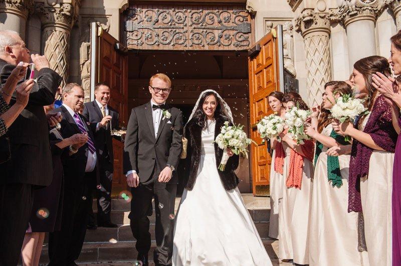 bride and groom exit st thomas church wedding st paul mn