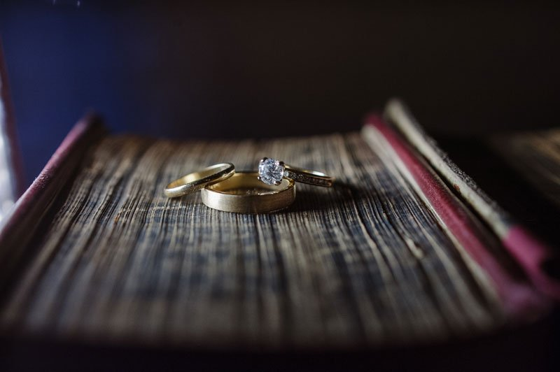 st paul mn wedding at jj hill library rings on old book