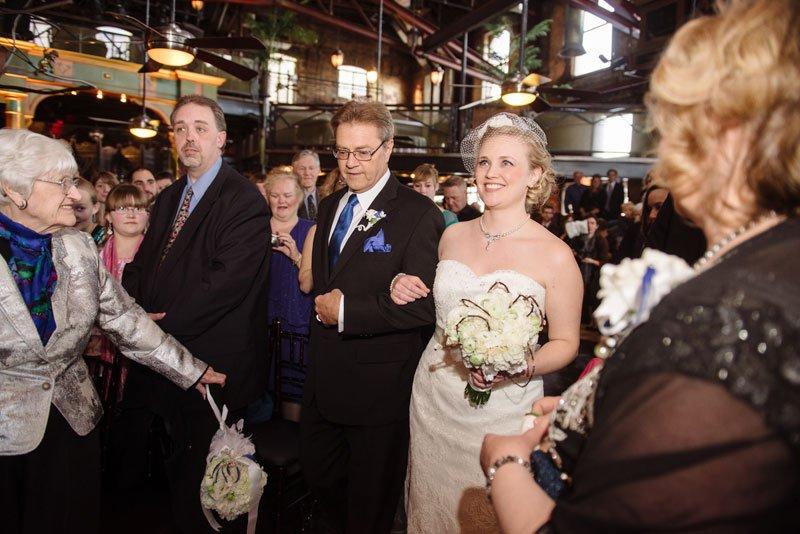 bride and father walk down aisle at loring pasta bar wedding minneapolis