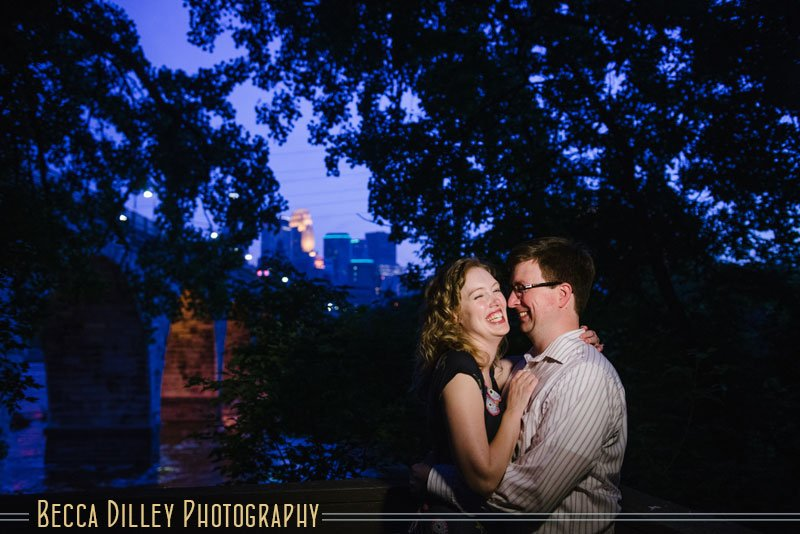 couple at night with Minneapolis skyline behind them