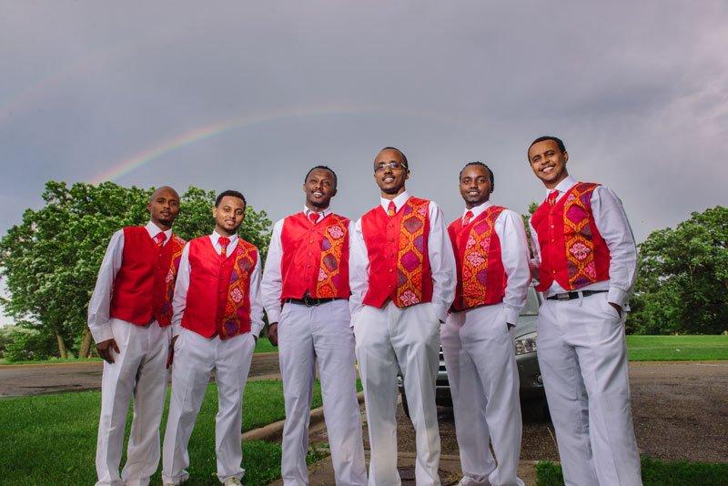 Ethiopian wedding groomsmen with rainbow