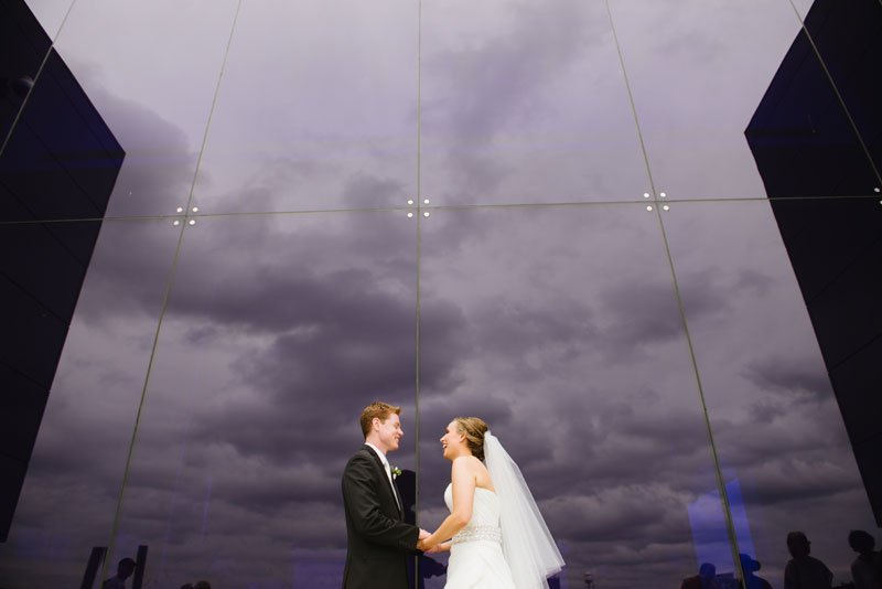bride and groom see each other for first time in front of blue window at Guthrie theater minneapolis mn
