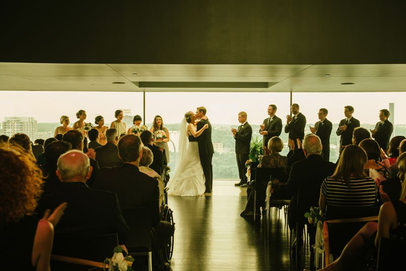 bride and groom kiss at wedding ceremony Guthrie theater minneapolis mn