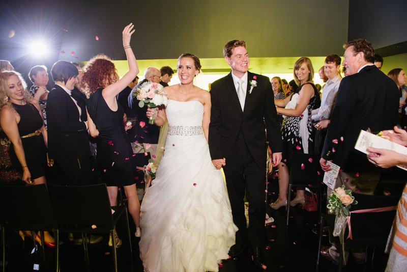 bride and groom walk down aisle Guthrie theater minneapolis mn