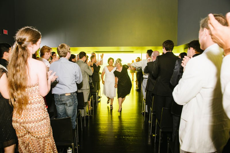 Guthrie theater wedding ceremony two brides coming down aisle