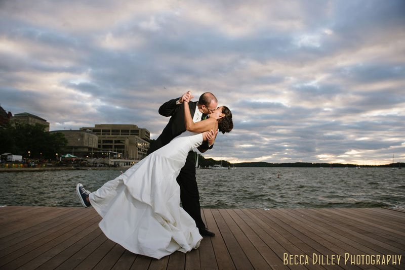 couple on new pier in front of memorial union wedding madison wi