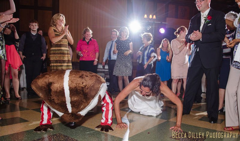 bride does push ups with bucky badger mascot at memorial union tripp commons wedding madison wi