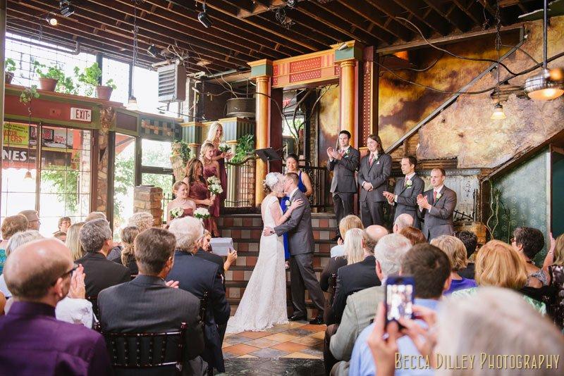 bride and groom kiss at loring pasta bar minneapolis wedding
