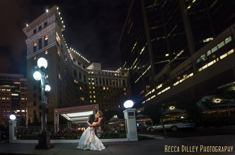 panorama at night of bride and groom outside of st paul hotel