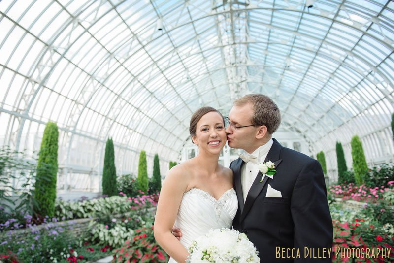 bride and groom inside conservatory at como park st paul mn