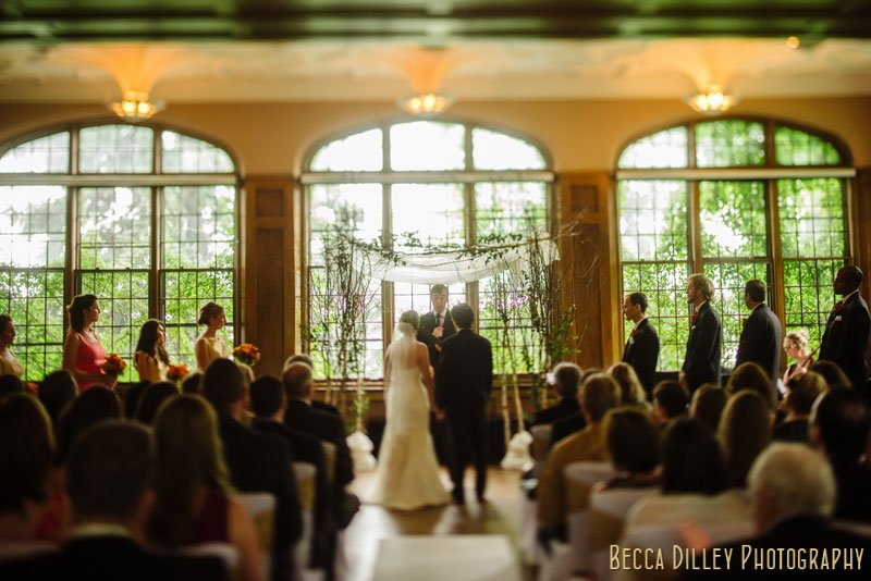 bride and groom under chuppah at st paul university club wedding