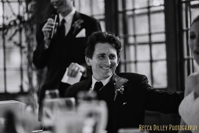groom laughs during toasts at st paul university club wedding