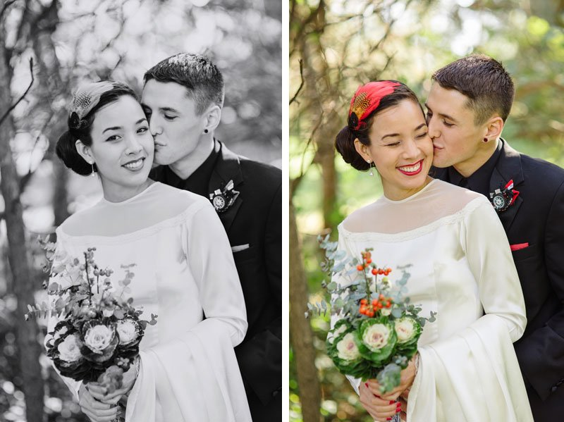 groom kisses brides cheek, bride has bouquet of cabbage and is wearing grandmothers gown