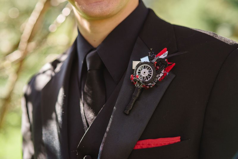 groom with lego motocross boutonniere on lapel