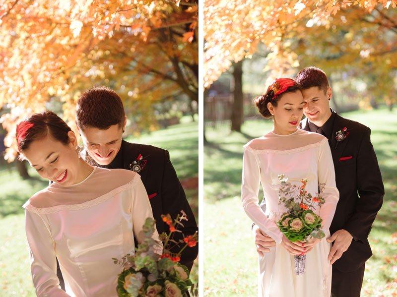 bride and groom under orange leaves