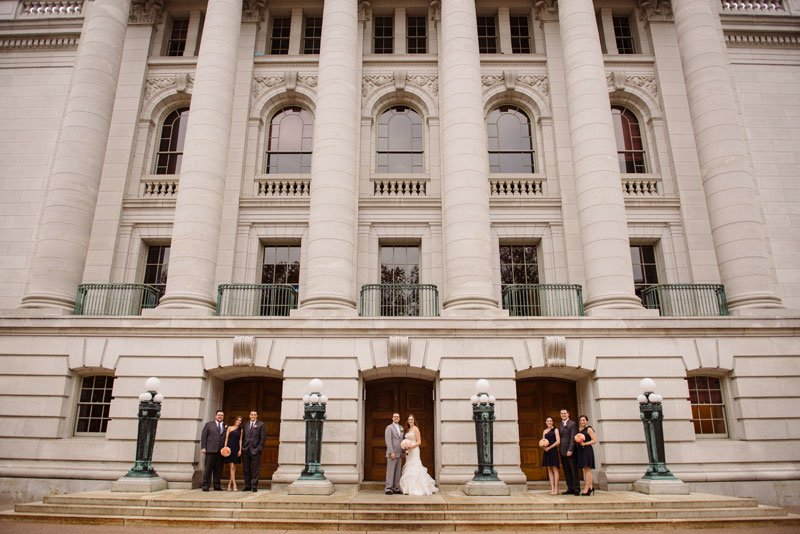 wedding party with architecture of madison capitol building