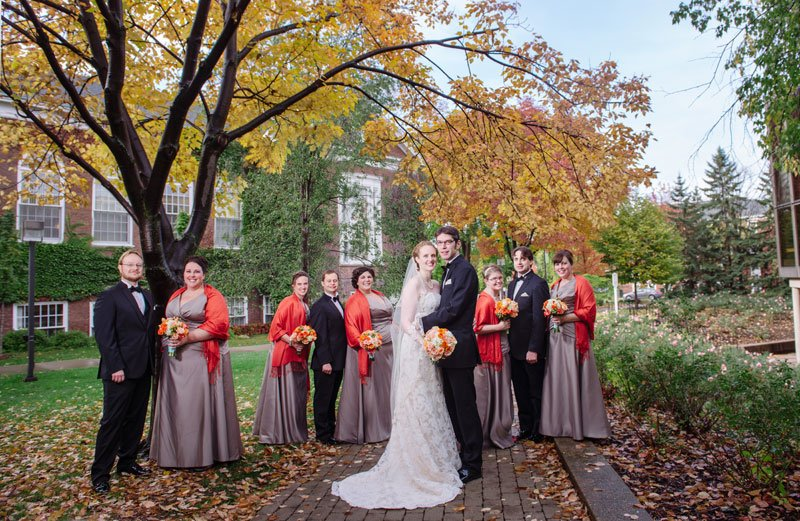 flash composite of wedding party with neutral dresses and orange wraps MN History Center Wedding