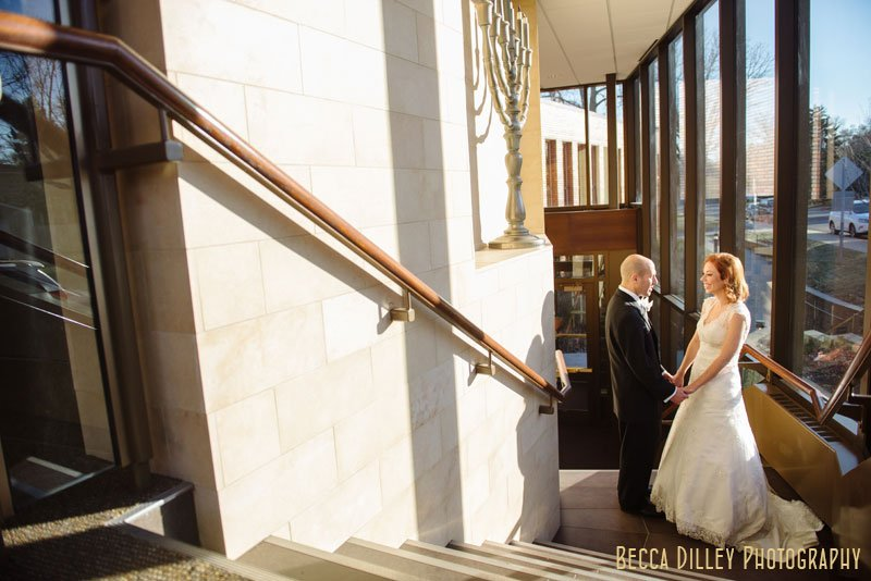 bride and groom inside Beth El Synagogue in St Louis Park MN