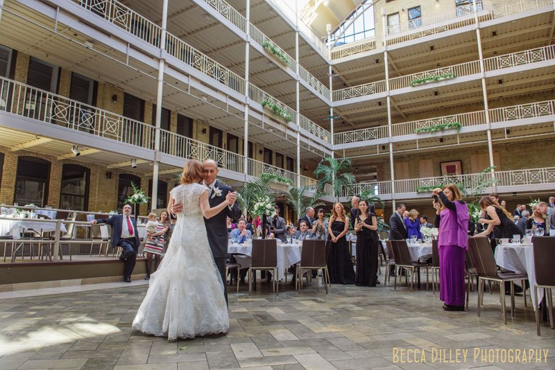 bride and groom first dance at IMS Design Center wedding reception