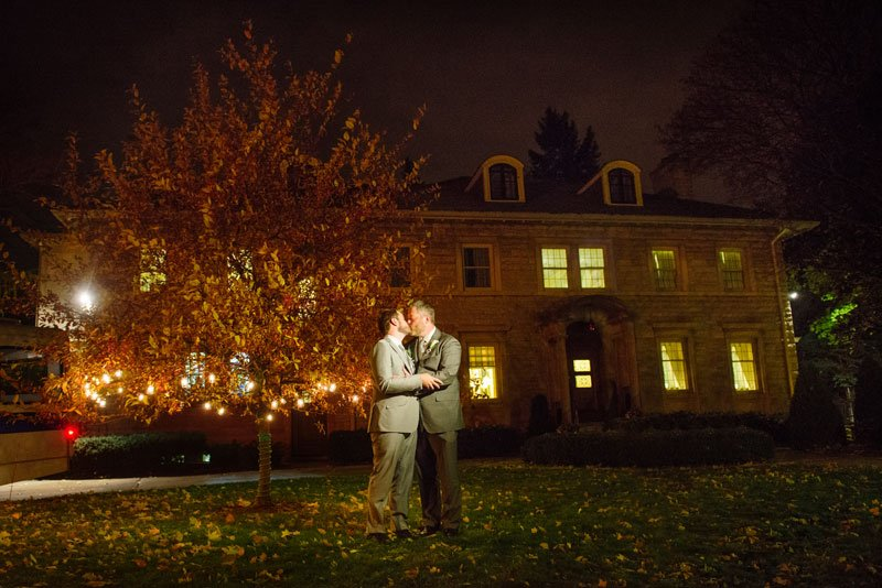 two grooms outside st paul college club wedding mn
