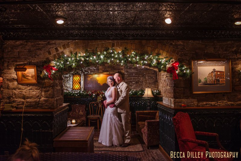 bride and groom under arch of basement at WA frost wedding st paul mn