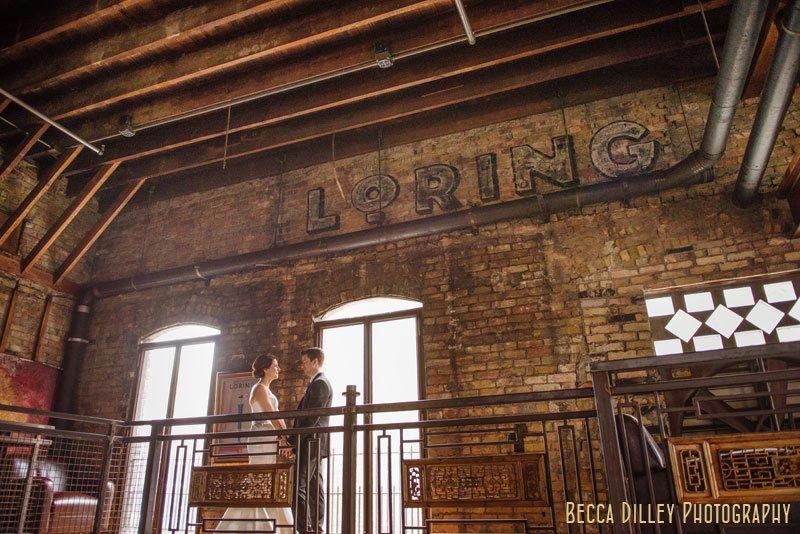 bride and groom under brick at wedding at loring pasta bar dinkytown