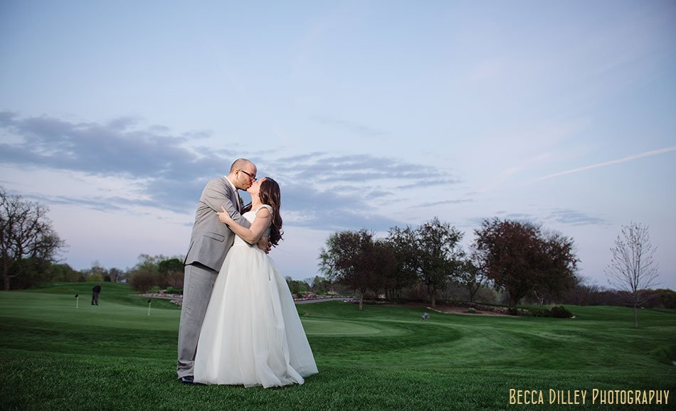 bride and groom at sunset on lawn of Windsor Country Club wedding Madison Wi