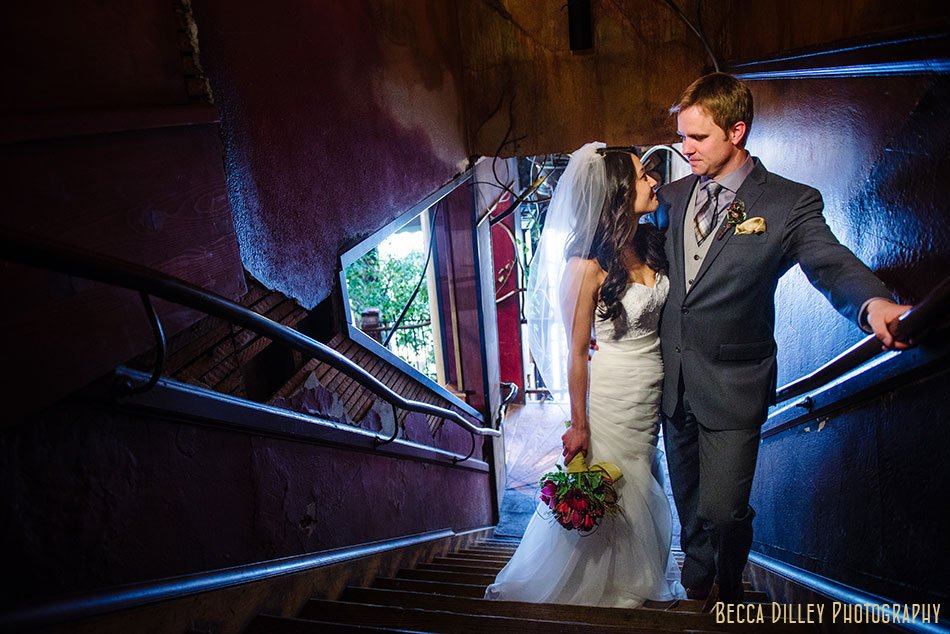 bride and groom in blue stairwell of Loring Pasta Bar Minneapolis wedding