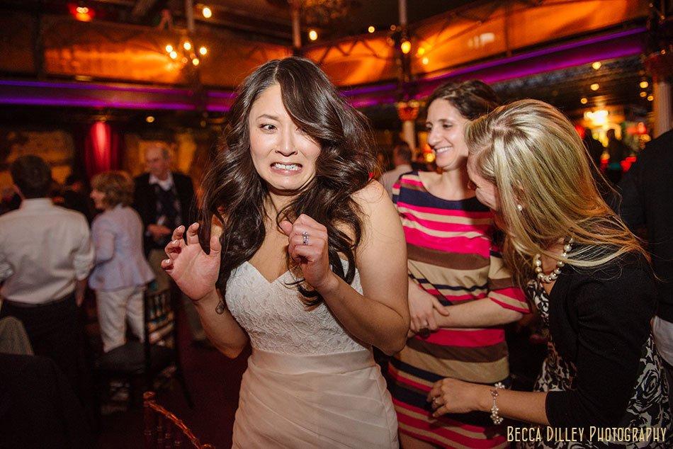 bride makes funny face at Varsity Theater wedding Minneapolis