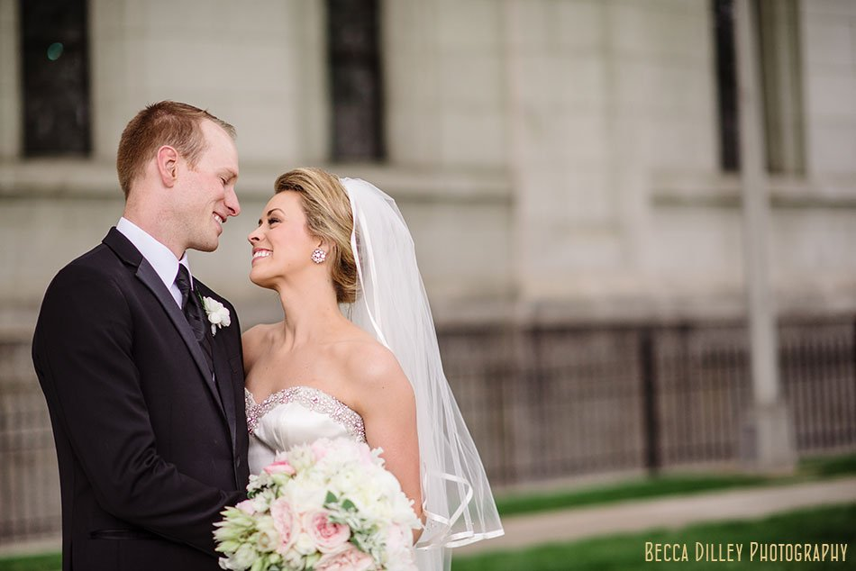 bride and groom outside of basillica wedding minneapolis