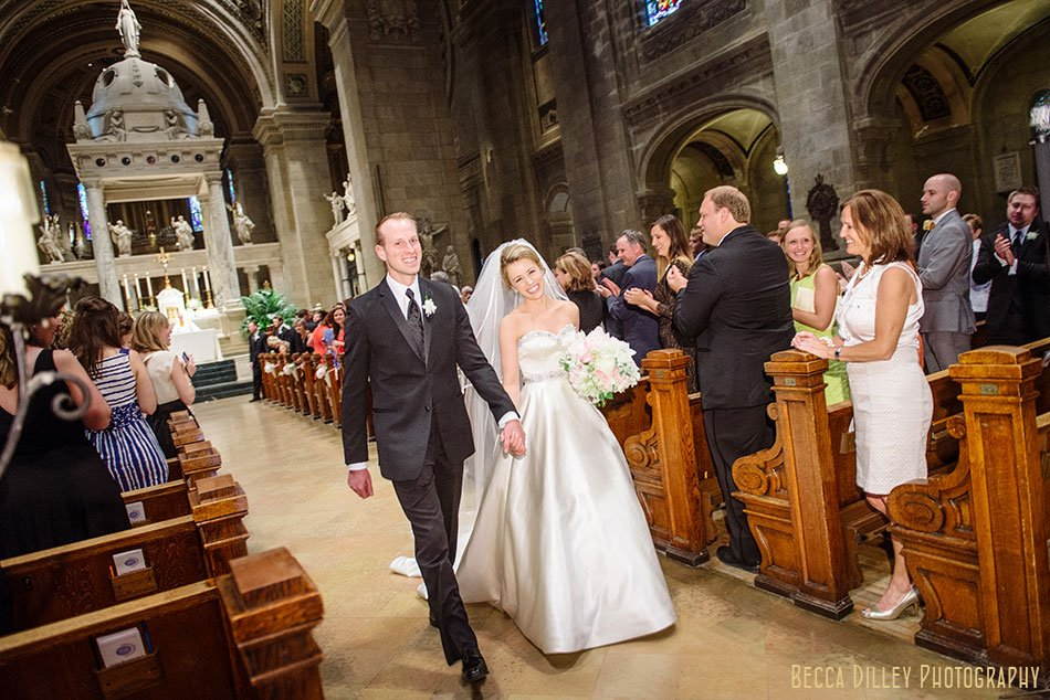 bride and groom walk down aisle basillica wedding minneapolis