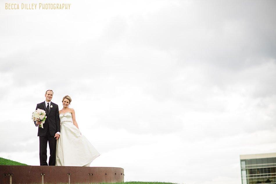 bride and groom outside gold medal park