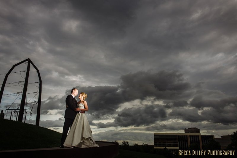 bride and groom with dramatic clouds gold medal park minneapolis