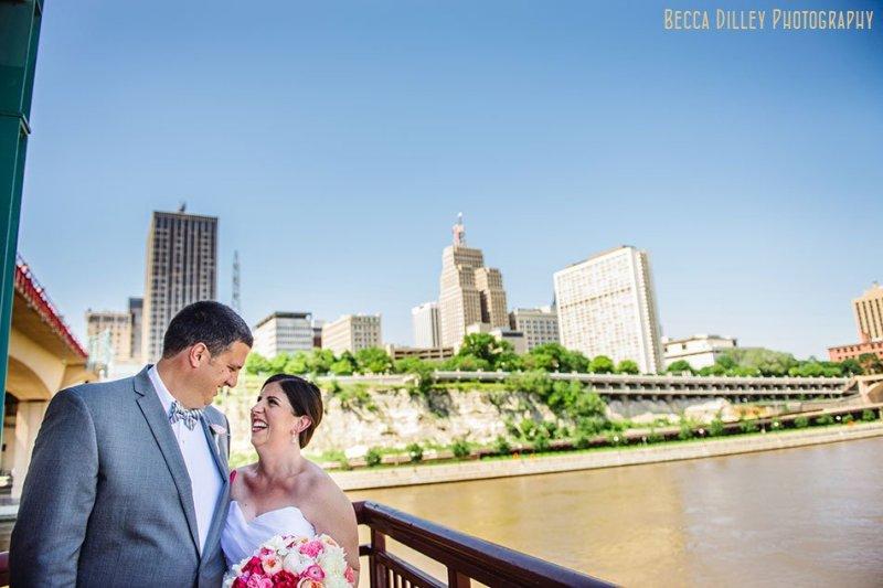 bride and groom with st paul skyline