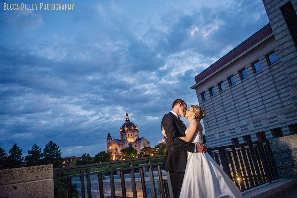 bride and groom at night outside minnsota history center