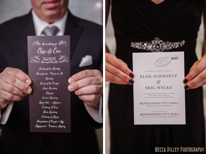 wedding party holds invitations for minneapolis city hall wedding