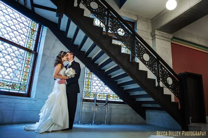 bride and groom under staircase at minneapolis city hall wedding