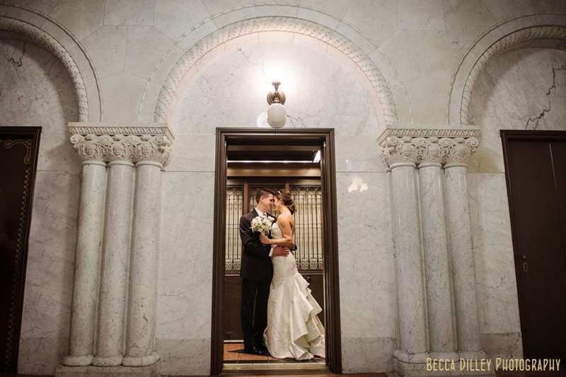 bride and groom in elevator for minneapolis city hall wedding
