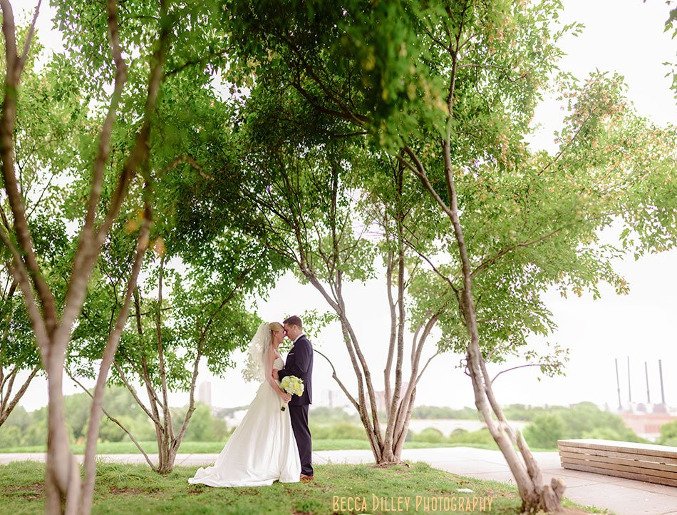 bride and groom on gold medal park