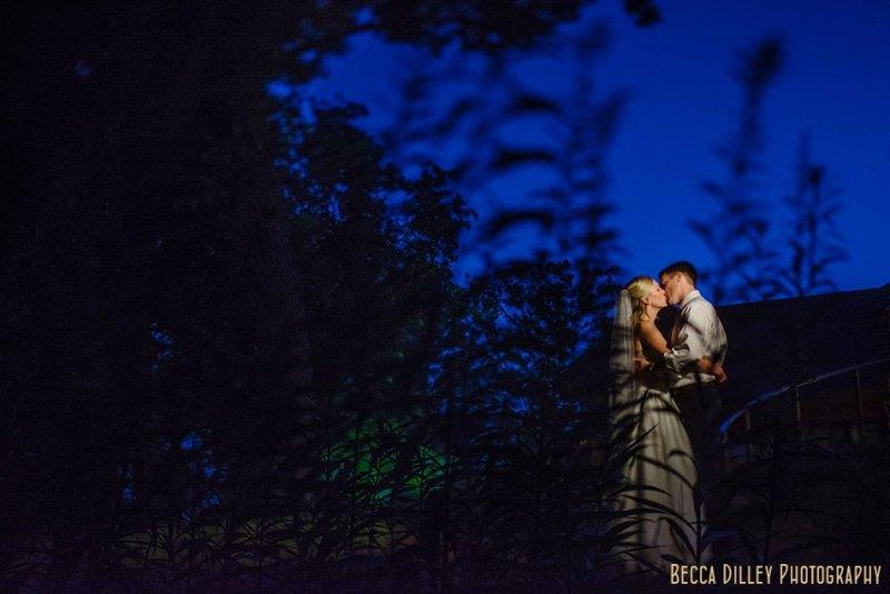 bride and groom at night at silverwood park minneapolis