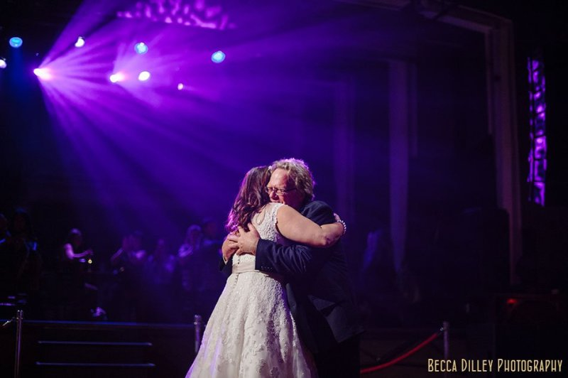 bride and father hug after dancing varsity theater wedding reception