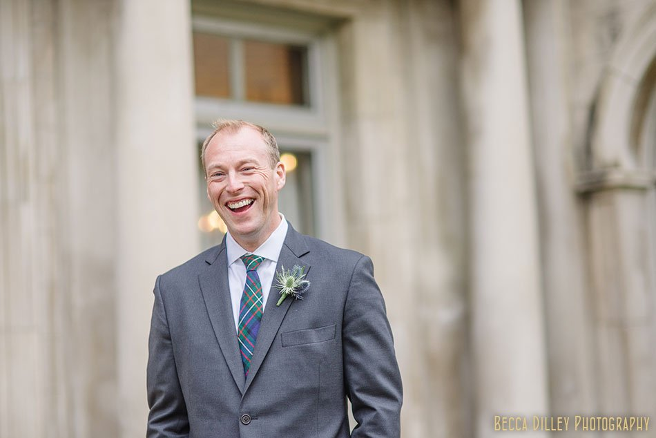 groom laughing outside minneapolis wedding at gale mansion