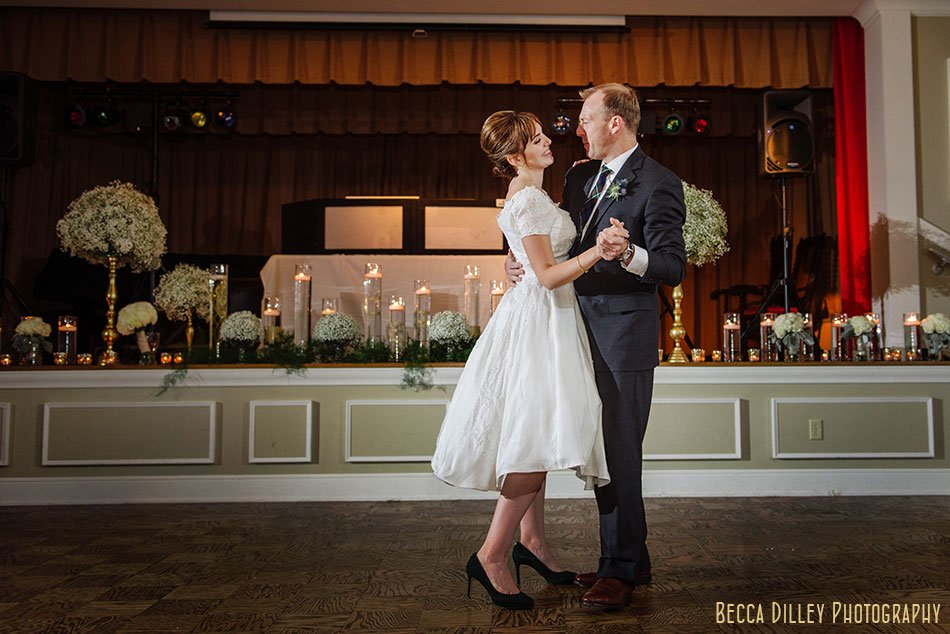 bride dances in grandmothers vintage wedding dress minneapolis wedding at gale mansion